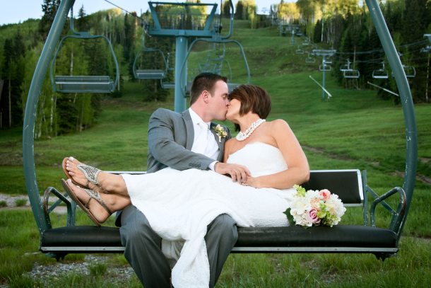 Couple kissing on a ski lift, Photographers in Durango CO, Durango Photography, Durango CO Photographers