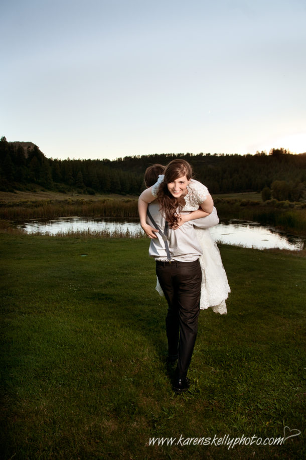 Groom carrying bride over shoulder, Photographers in Durango CO, Durango Photography, Durango CO Photographer