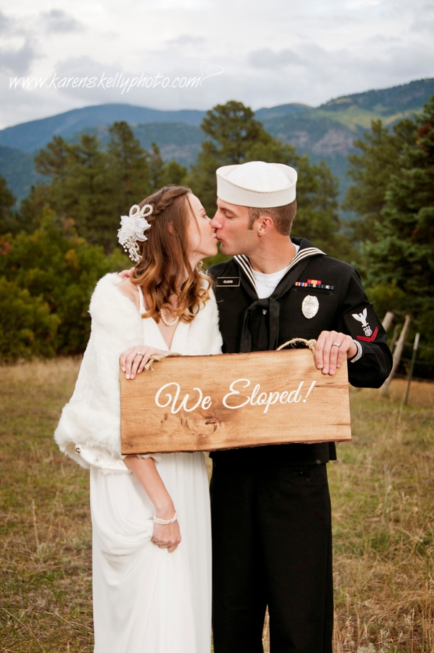 Bride and Groom with sign, photographers in durango co, durango co photographers, durango photography, durango wedding photographers