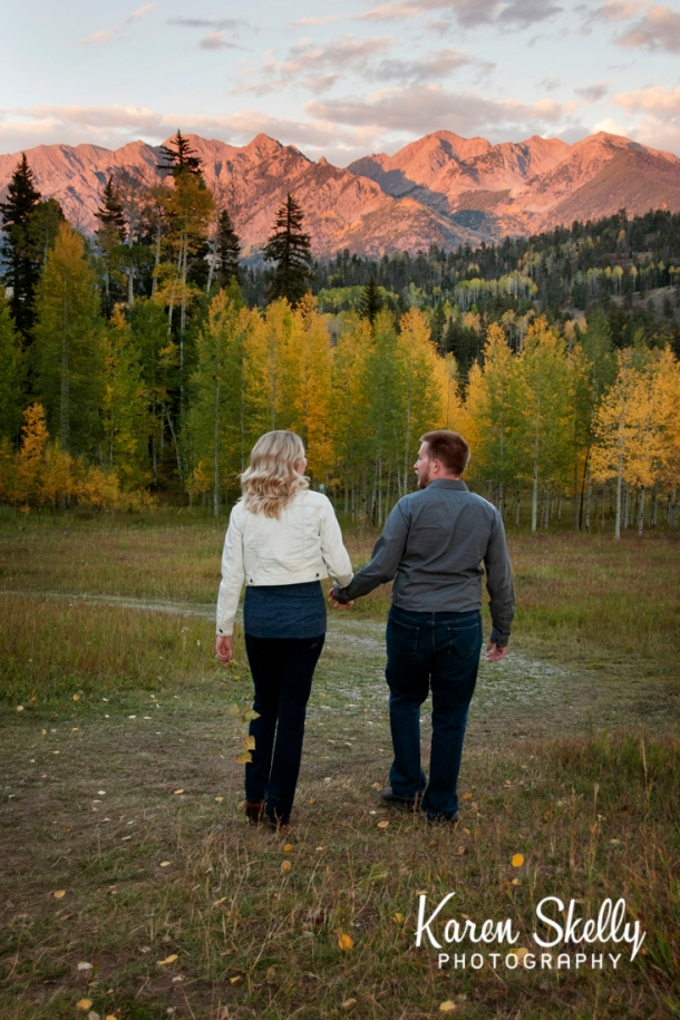 Engaged couple walking with fall colors, durango photography, photographers in durango co, durango co photographers, durango wedding photographers