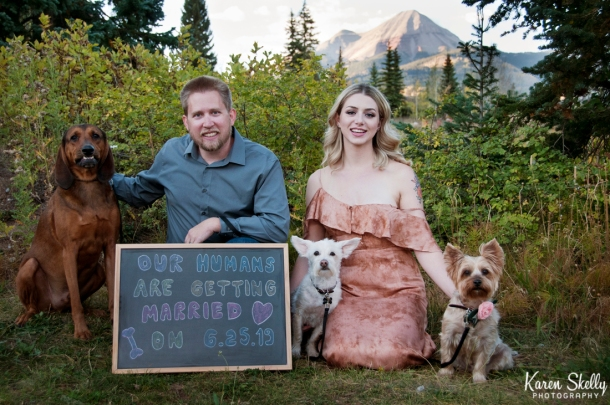 Engaged couple with doggies and chalk board announcing wedding, durango photography, photographers in durango co, durango wedding photographers, durango photographers