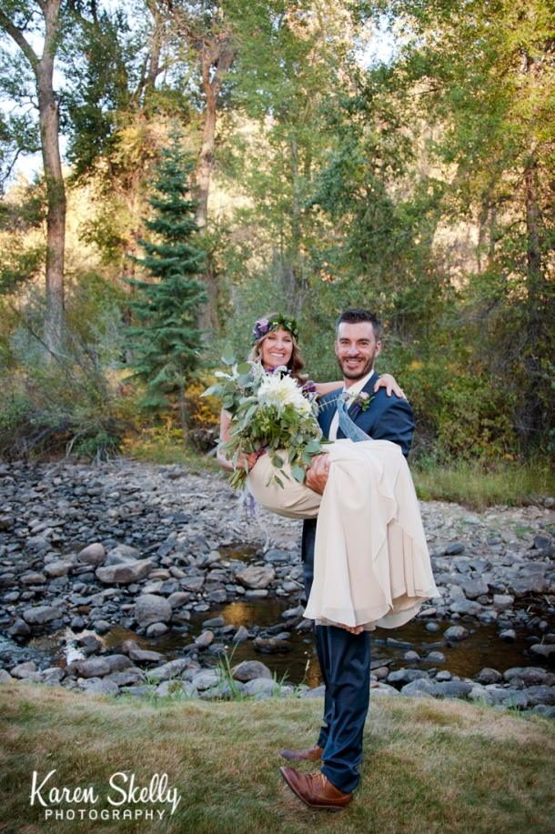 Groom carrying the Bride by Photographers in Durango CO, Durango CO Photographers, Durango Wedding Photographers, Wedding Photographers in Durango CO