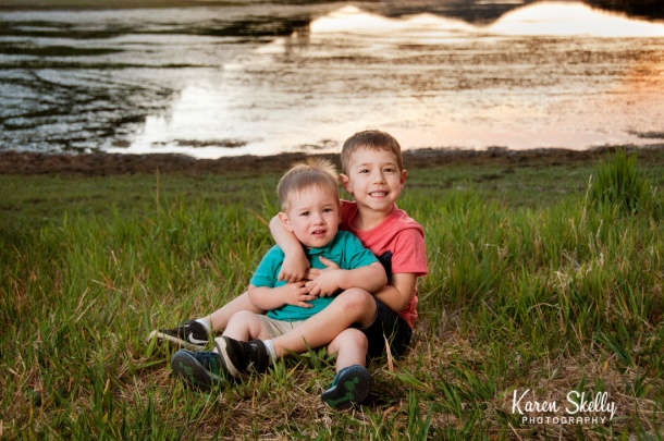 Two little brothers by a lake, photographers in durango co, durango photography, durango co photographers, durango photographers, durango family photographers