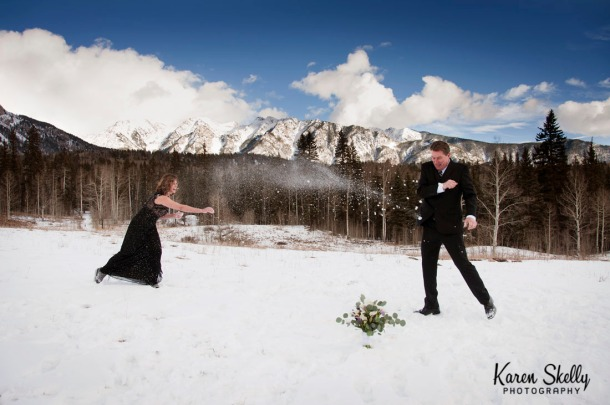 Bride and Groom having a snowball fight, photographers in durango co, durango co photographers, durango wedding photographers, durango photography, wedding photographers in durango co