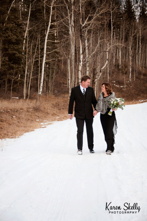 Bride and Groom walking down a snowy road, photographers in durango co, durango co photographers, durango wedding photographers, durango photography, wedding photographers in durango co