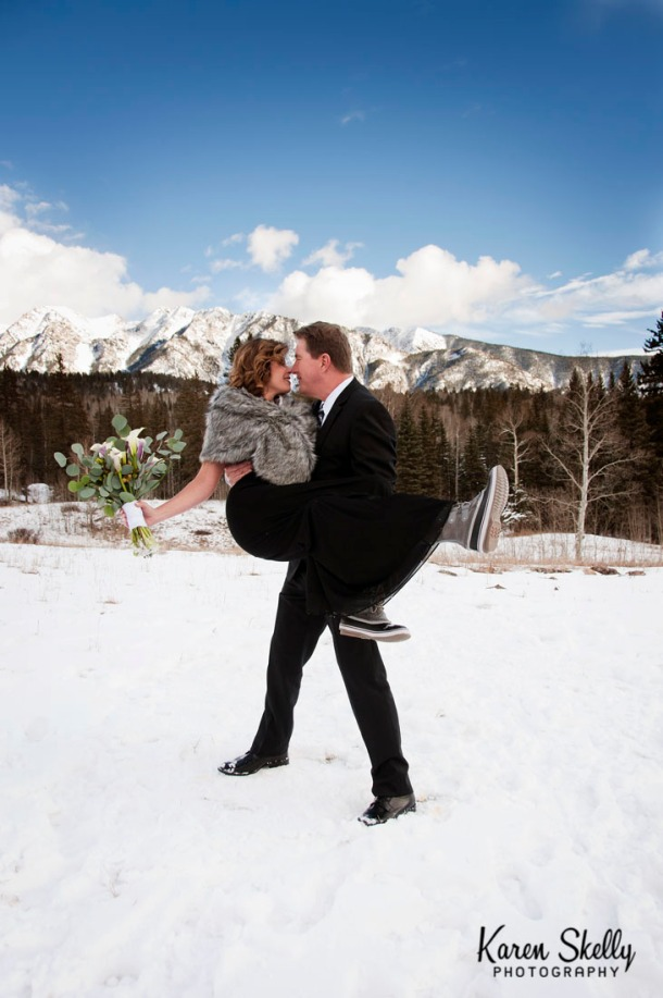 Groom carrying bride in the snow, photographers in durango co, durango co photographers, durango photography, durango wedding photographers, wedding photographers in durango co