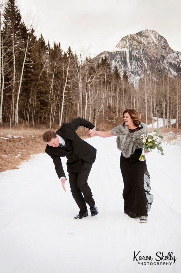 Blooper - Groom slips in the snow, photographers in durango co, durango co photographers, durango photography, durango wedding photographers, wedding photographers in durango co