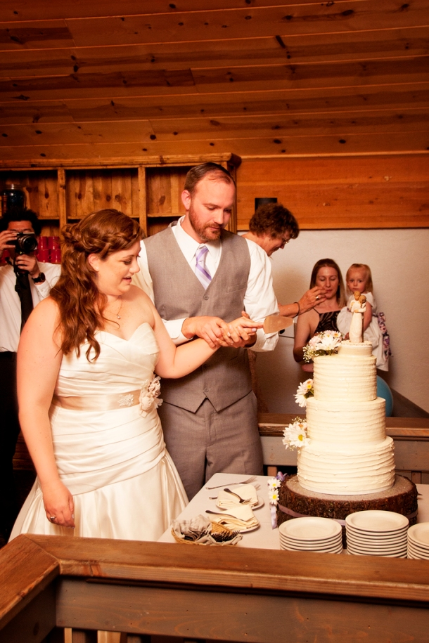 Bride and groom cutting the cake, photographers in durango co, durango photography, durango photographers