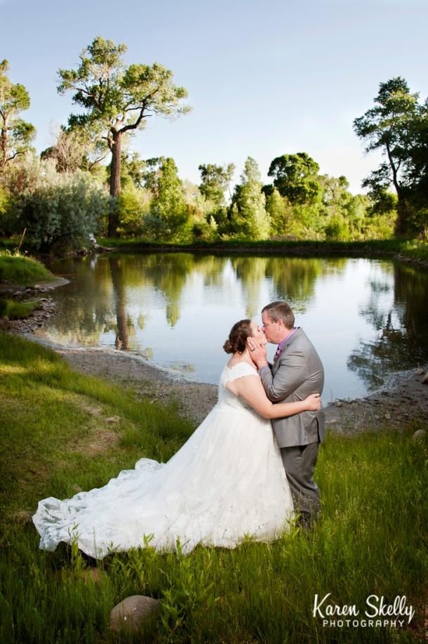 Bride and Groom kissing by a lake, photographers in durango co, durango photography, durango photographers