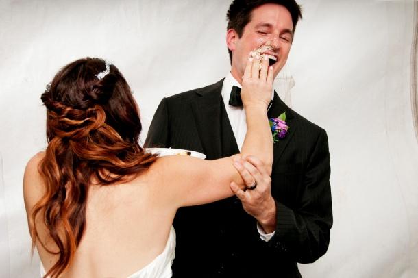 Bride smashing cake into groom's face, photographers in durango co, durango photography, durango photographers