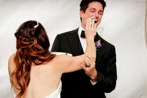 Bride smashing cake into groom's face, photographers in durango co, durango photography, durango photographers
