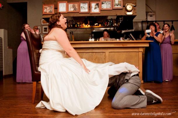 Groom removing bride's garter, photographers in durango co, durango photography, durango co photographers