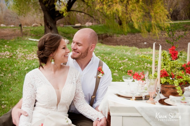 Bride and Groom sitting at table, photographers in durango co, durango co photographers, durango photography