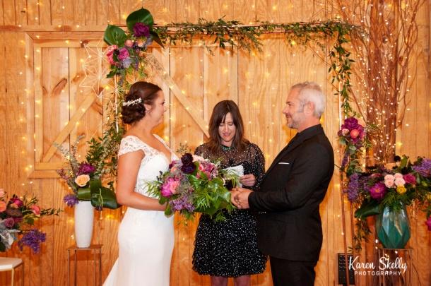 Couple holding hands during wedding, durango co photographers, durango photography, photographers in durango co