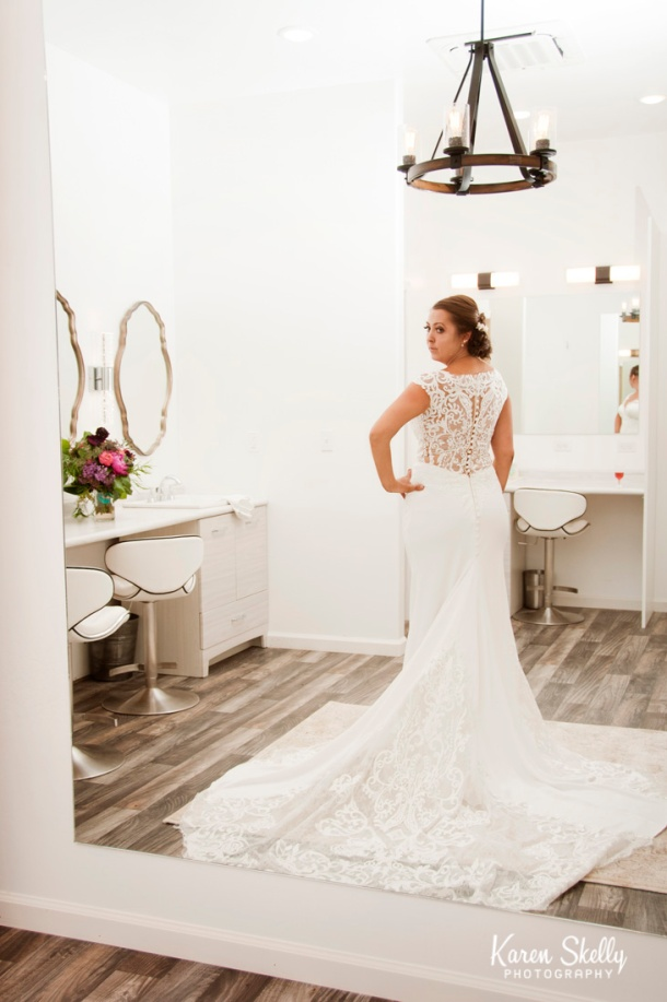 Bride looking at her dress in mirror, photographers in durango co, durango photography, durango photographers, durango wedding photographers