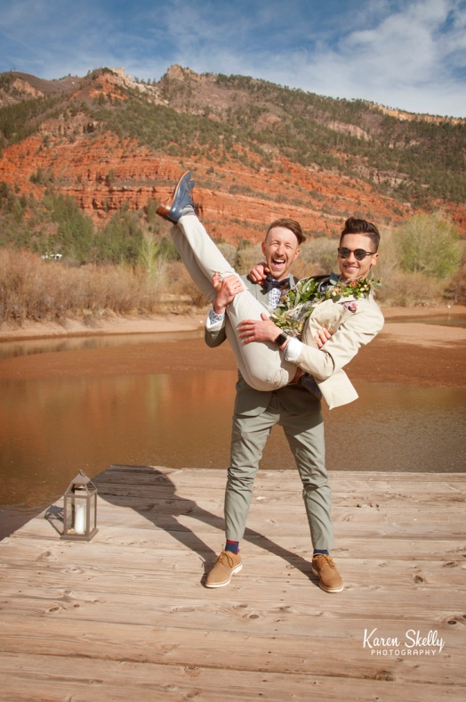 Groom picking up groom, photographers in durango co, durango photography, durango co photographers