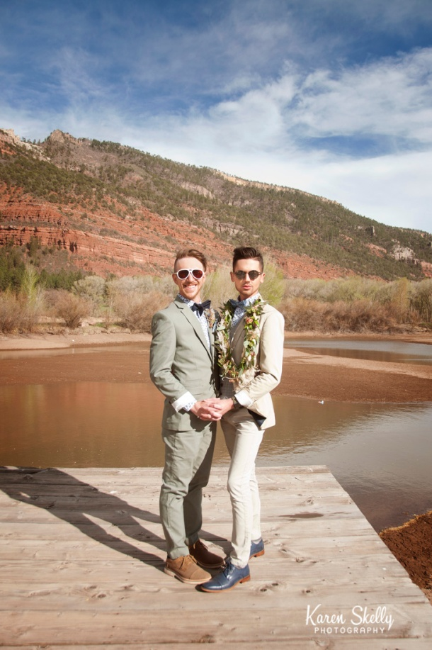 Groom and Groom standing on a dock, durango photography, durango co photographers, photographers in durango co