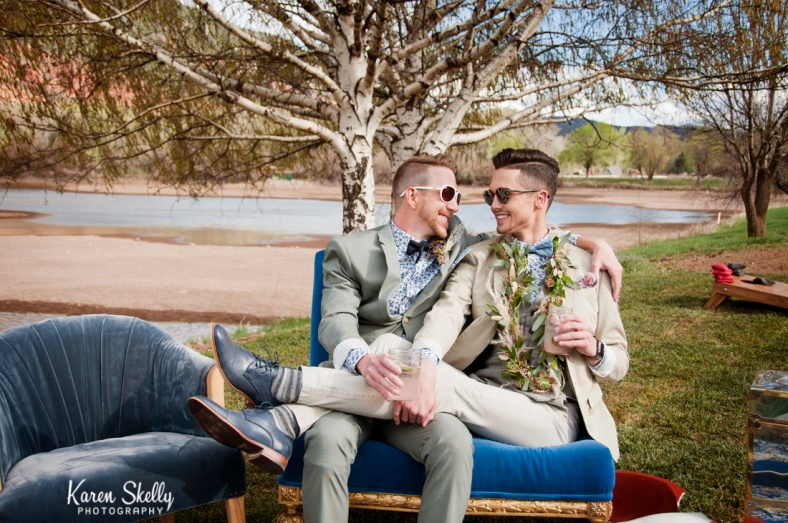 Groom and Groom cuddling on couch, photographers in durango co, durango photography, durango co photographers