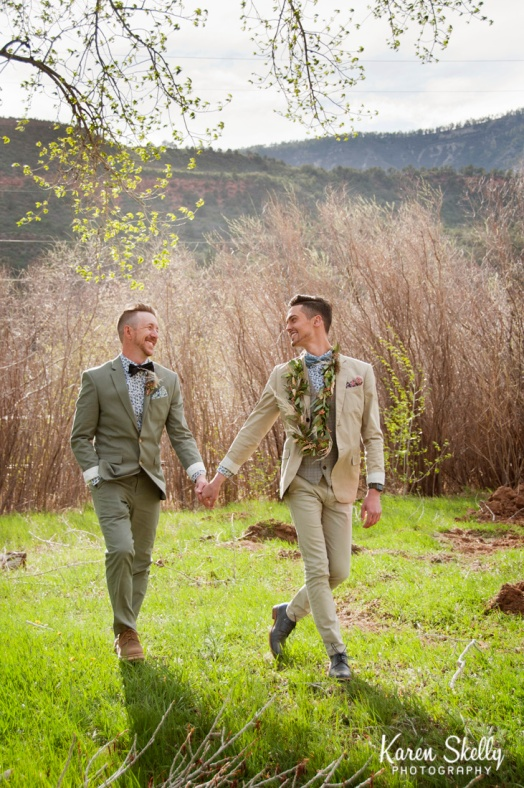 Groom and Groom holding hands walking, photographers in durango co, durango photography, durango co photographes
