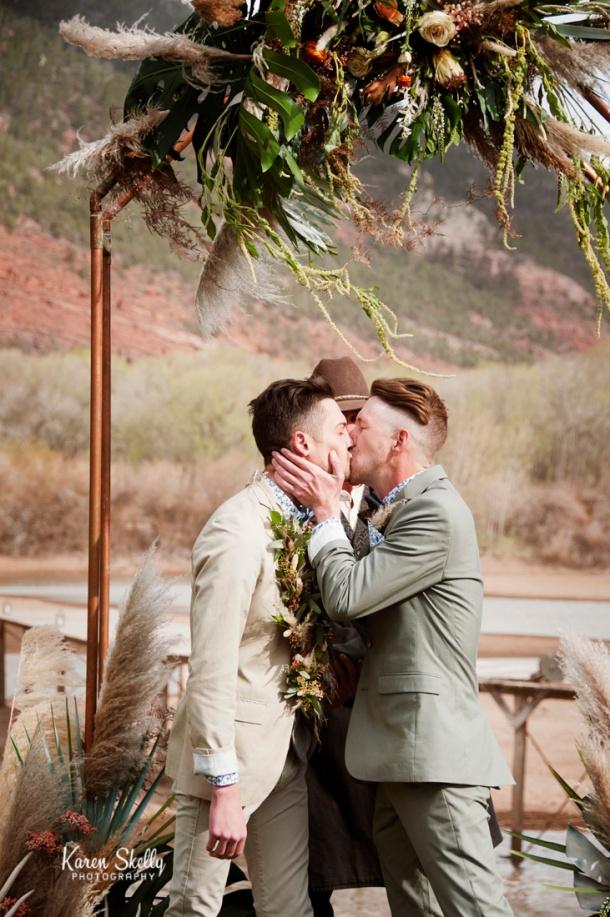 Groom and Groom's first kiss, durango photography, durango co photographes, photographers in durango co