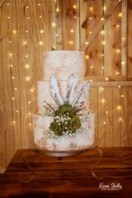 Wedding cake with flowers and feathers, durango photography, photographers in durango co, durango co photographers