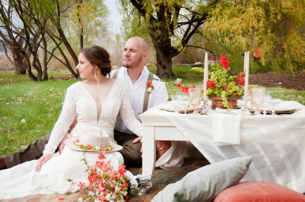 Bride and Groom sitting at table, photographers in durango co, durango photography, durango co photographers, durango wedding photographers